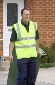 web0992_-_Man_collecting_green_recycling_wheelie_bin_outside_house_-_Web_Version__72ppi